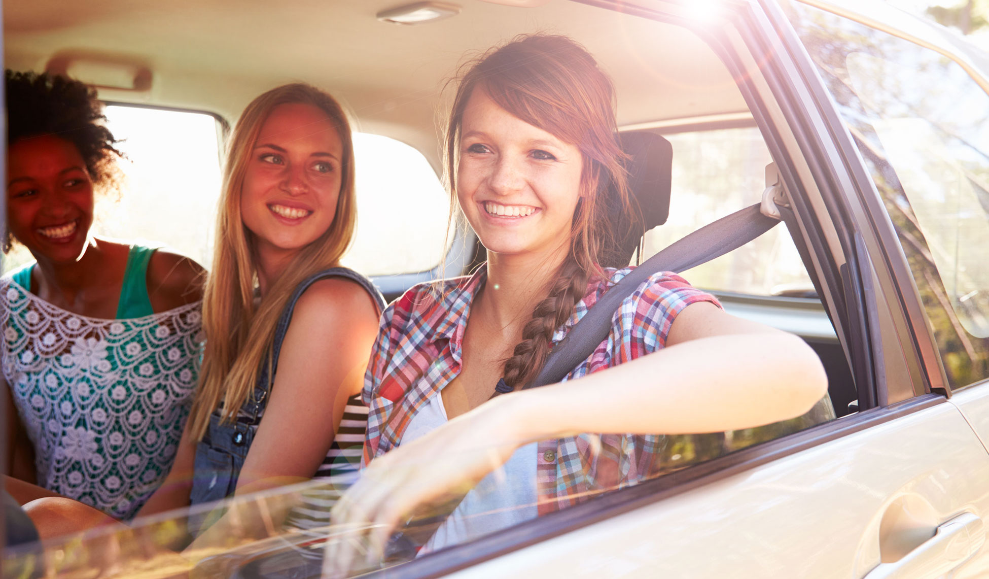 three_women_sitting_in_rear_seat_of_car_small